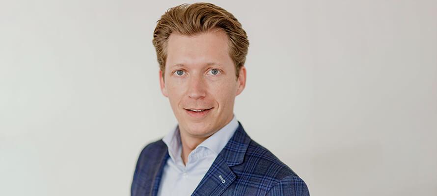 Sales Manager Rob Luyben van Leap. The Innovation Agency op een grijze achtergrond